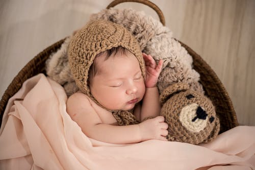 Baby Wearing Brown Knit Cap While Sleeping