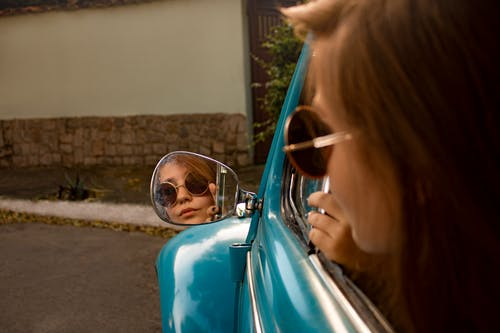 Woman Watching on Vehicle Side Mirror