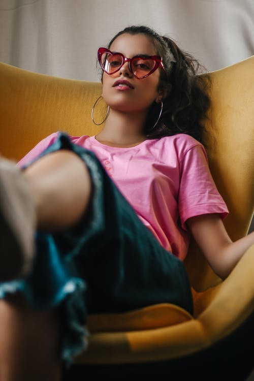 Woman Wearing Sunglasses And Pink Shirt