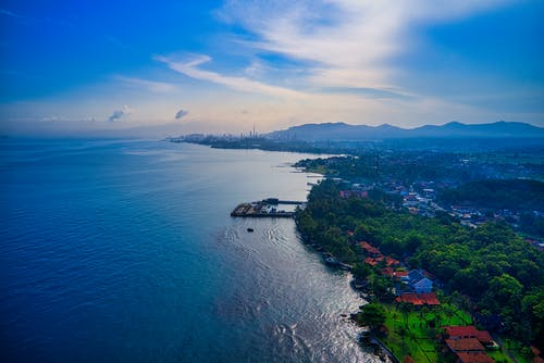 Green Island Under Blue Sky