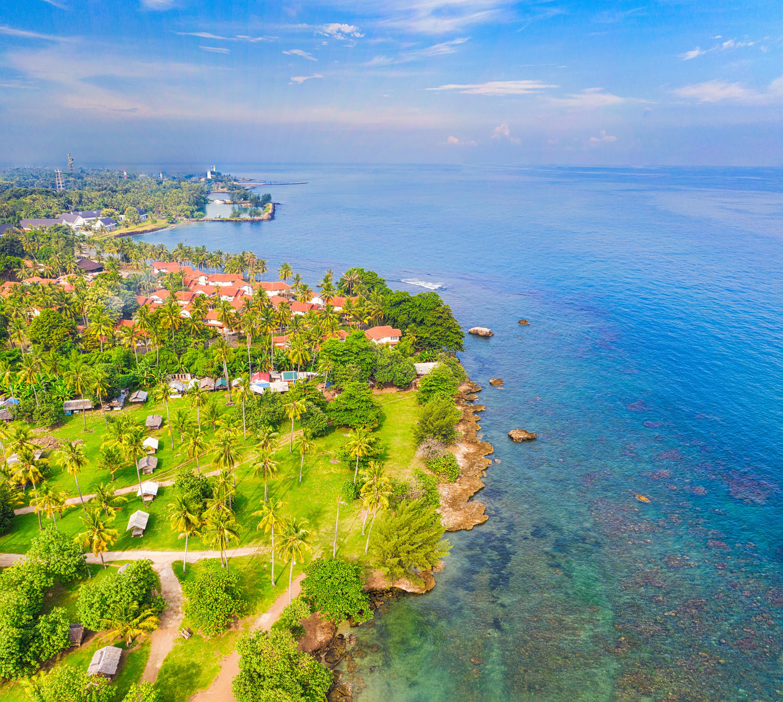 Aerial Photography of Sea Near House