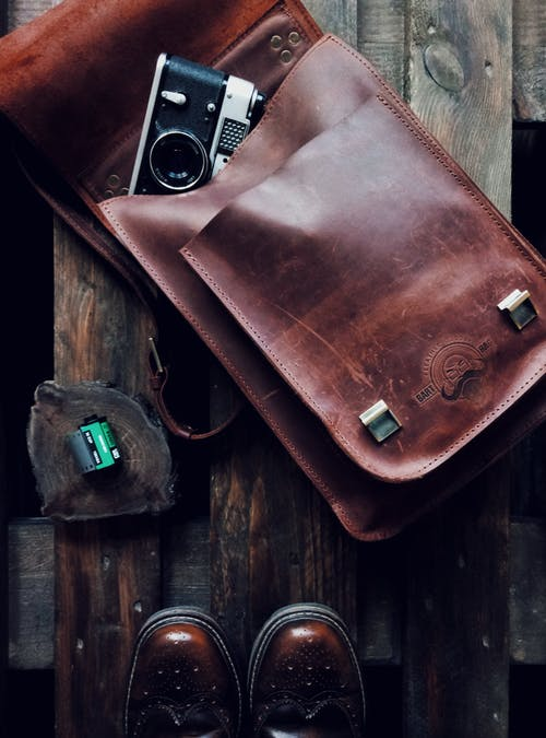 Black and Gray Camera on Brown Leather Bag