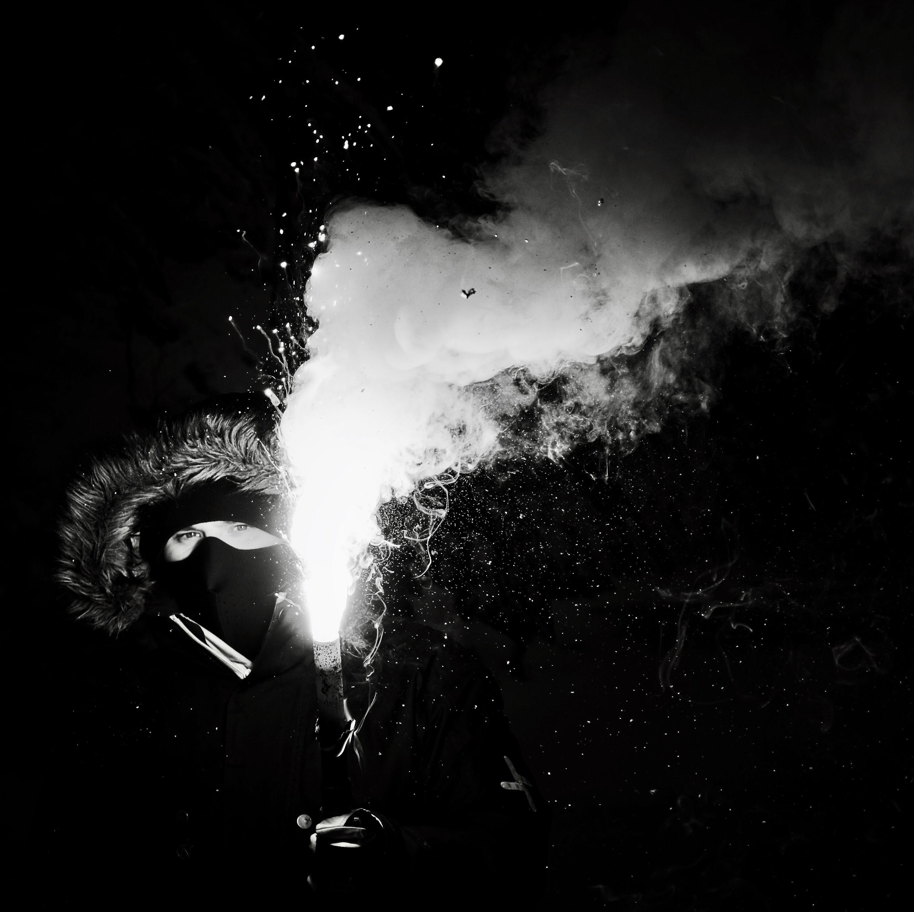 Grayscale Photography of Person Holding Flare