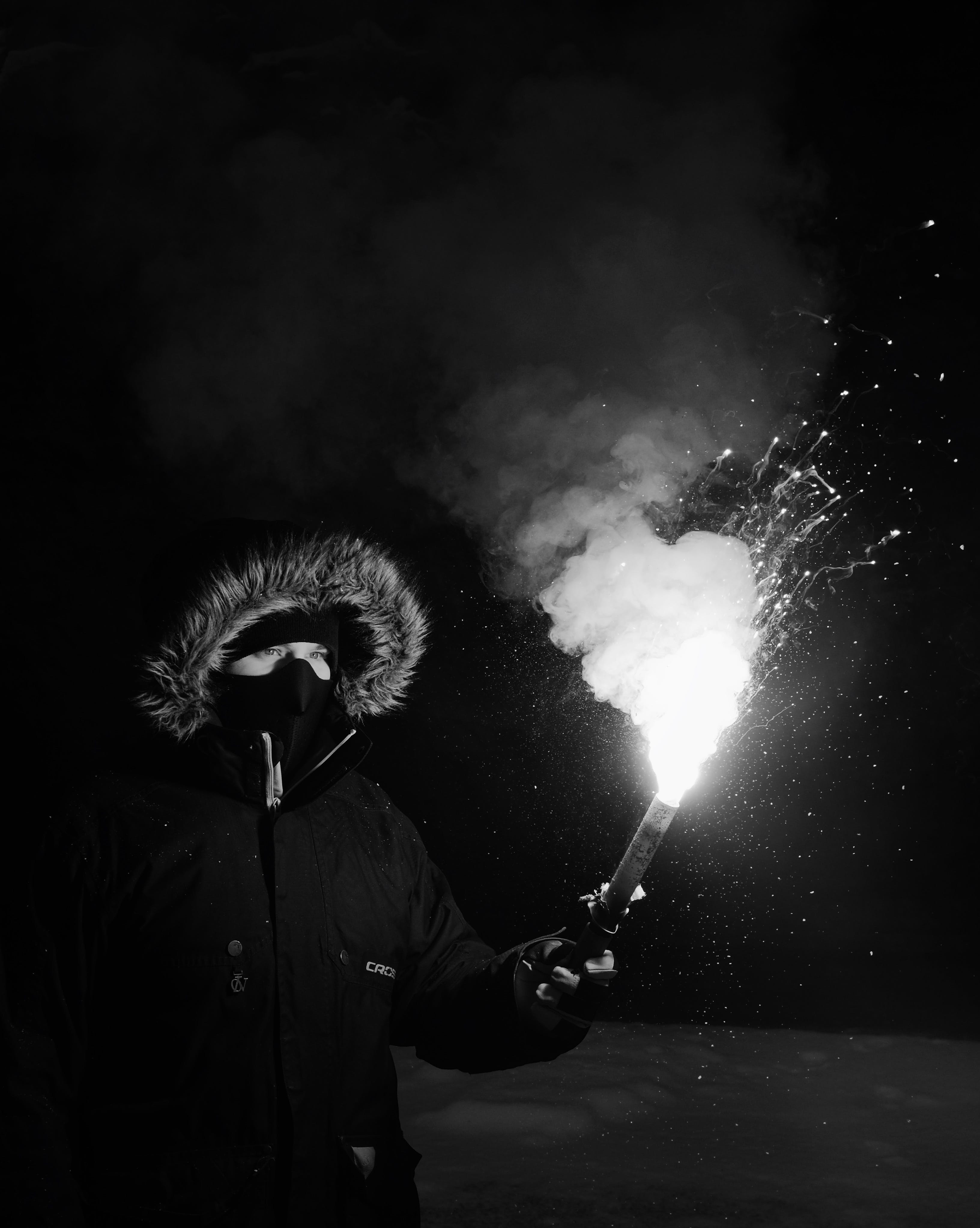 Person Wearing Coat Holding Firework