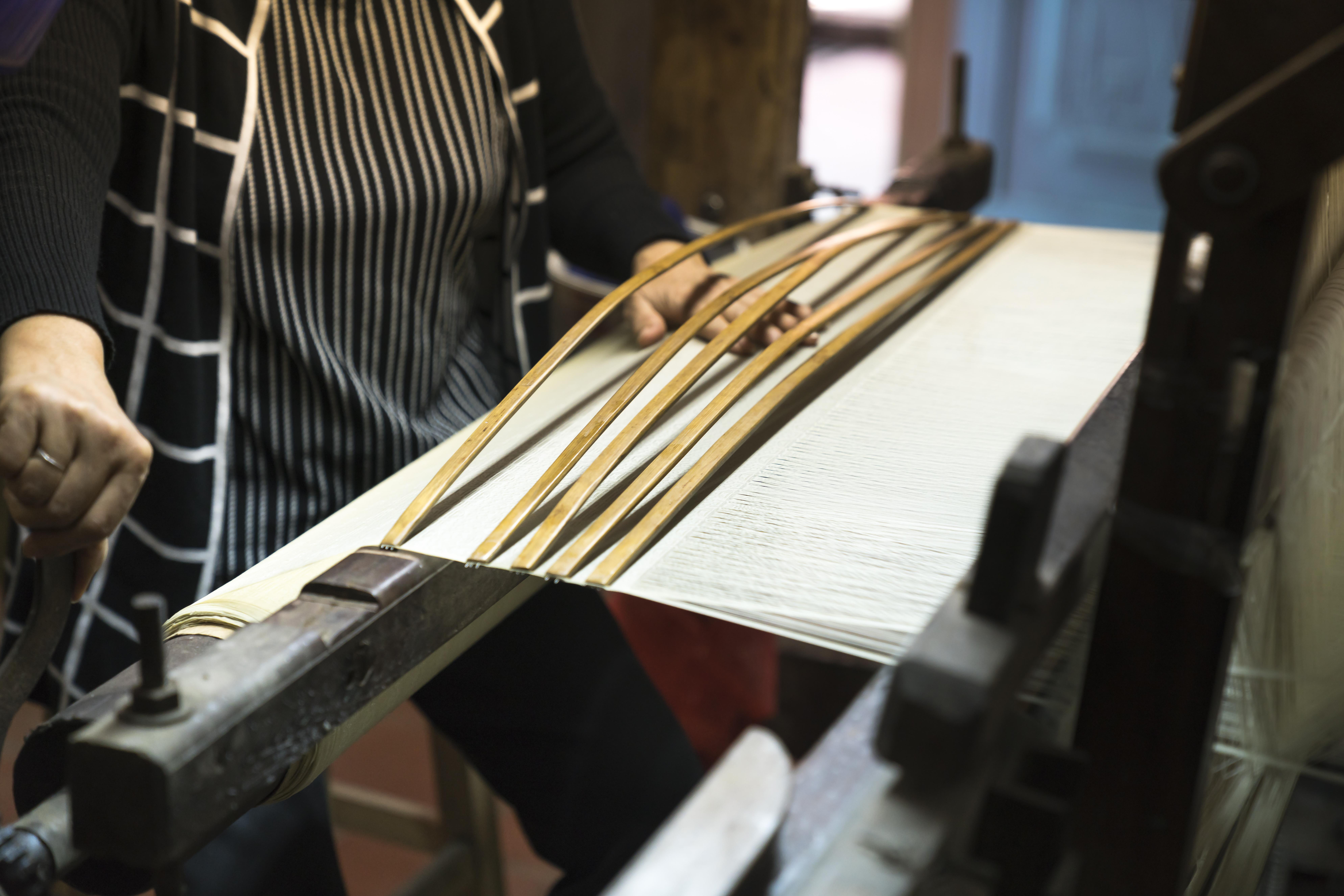Woman Weaving Brown Wooden Mat