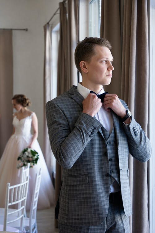 Man Wearing Gray Notched Lapel Suit Jacket