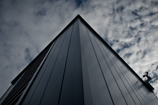 Worm's Eye View of Building Under White Cloudy Sky