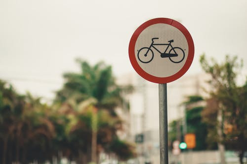 Selective Focus Photo of Bicycle Road Sign