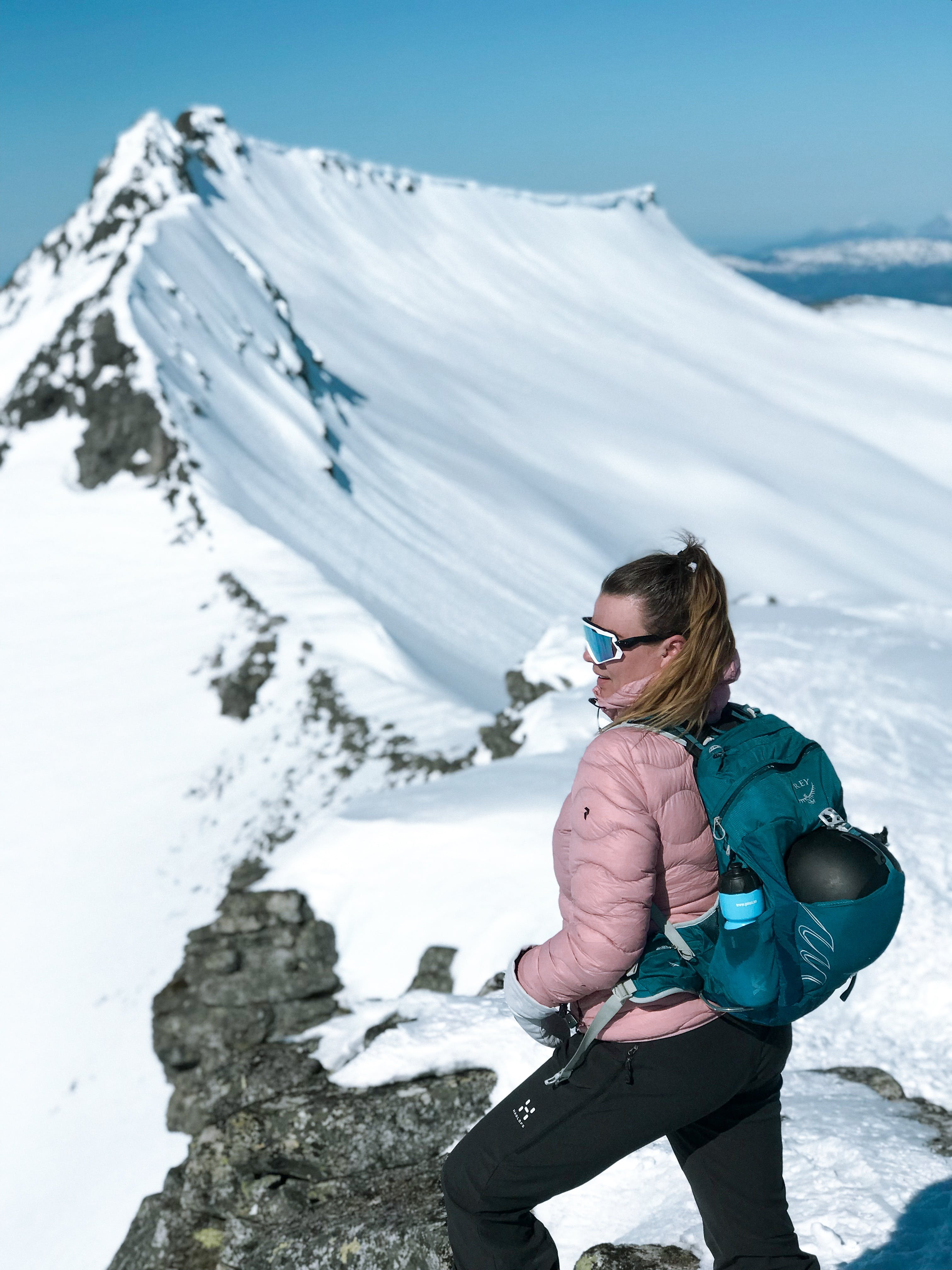 Photo of Woman On Top Of Snow Capped Mountain
