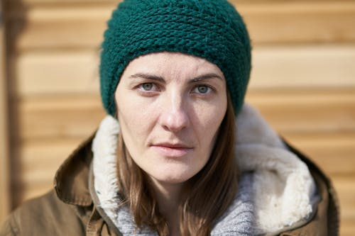Close-Up Photo of Woman Wearing Green Beanie