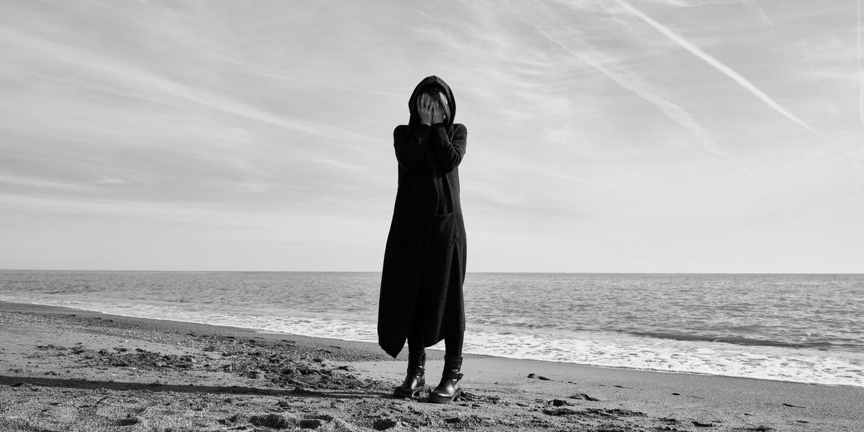 Woman Standing at the Beach