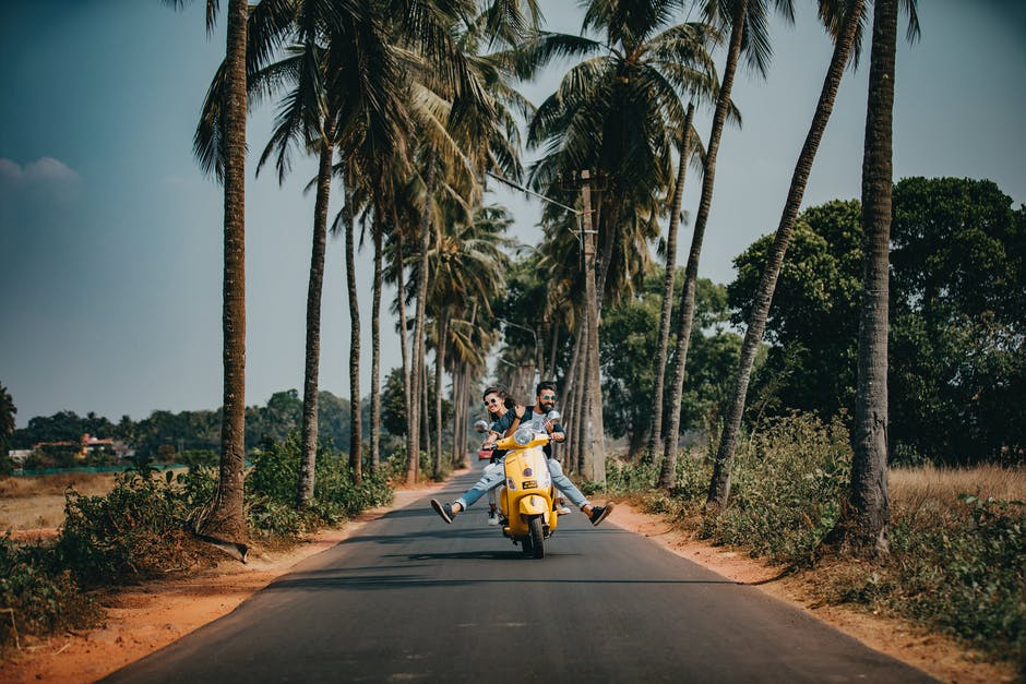 Woman and man riding on motorcycle