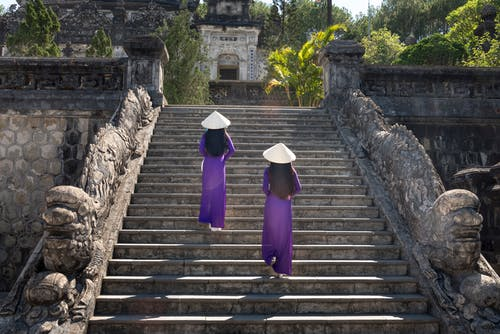 Two Women Climbing on Stairs