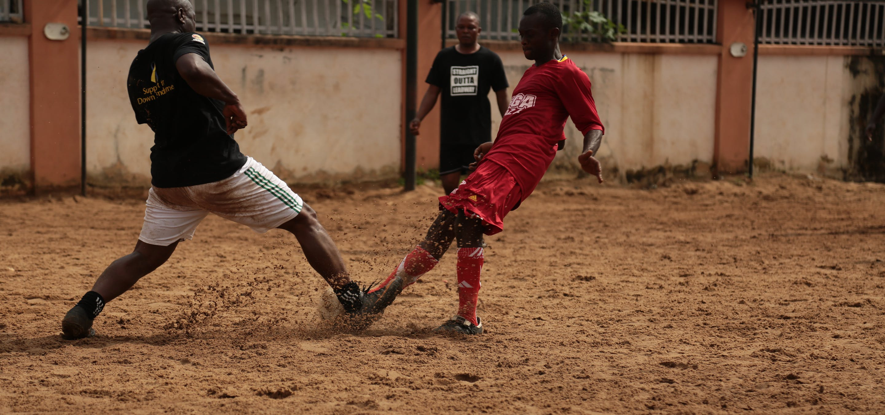 2 Soccer Player Playing for a Ball