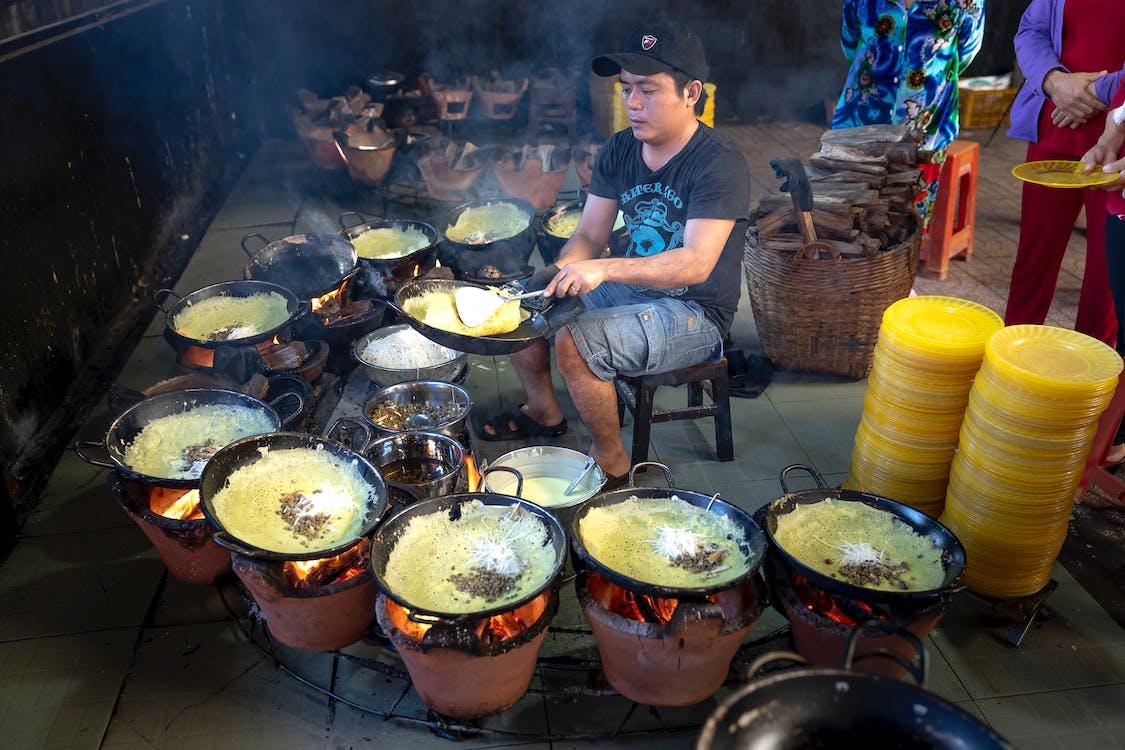 Man Cooking While Sitting