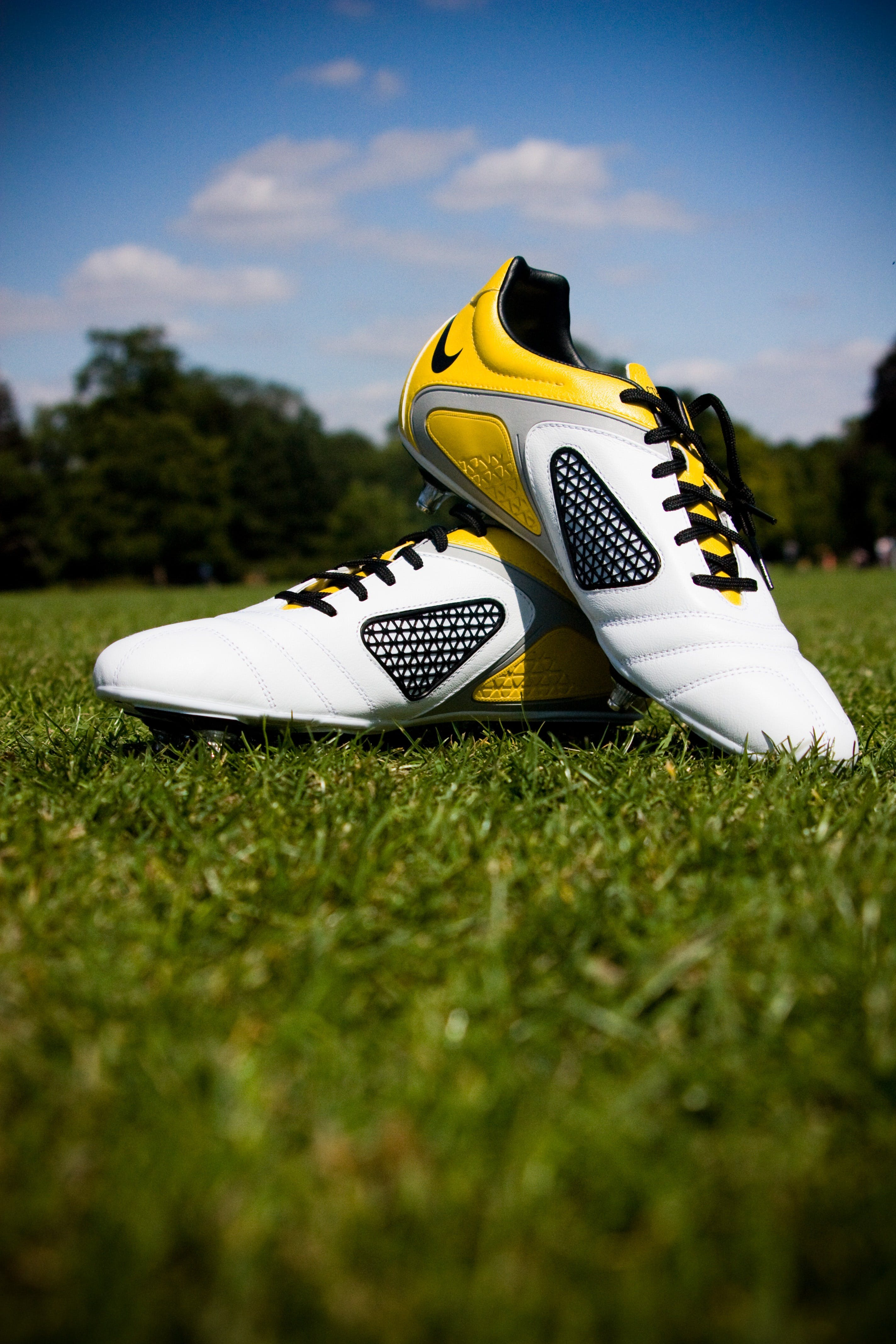 Pair of White-and-yellow Nike Cleats