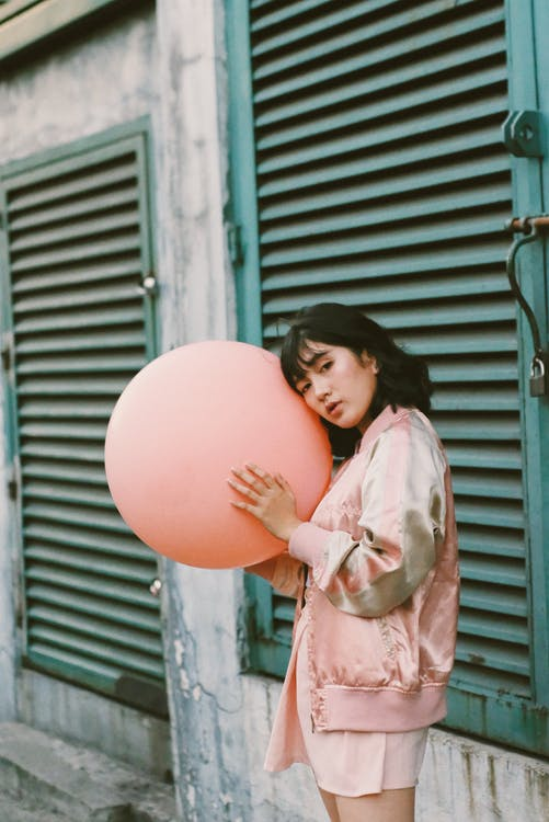 Woman Holding Pink Balloon