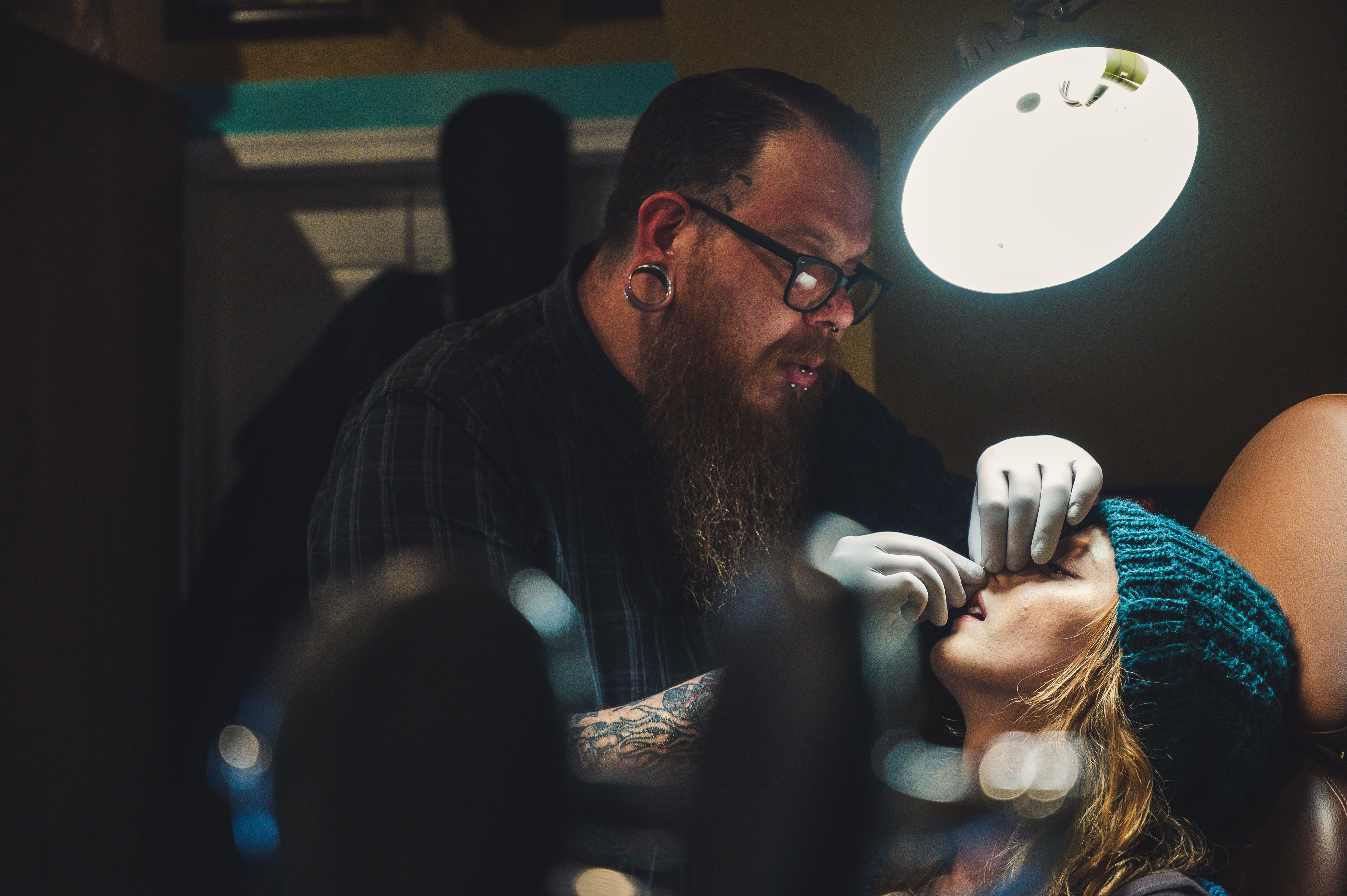 Man Piercing Woman