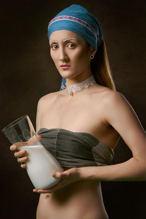 Woman Holding Clear Glass Jar