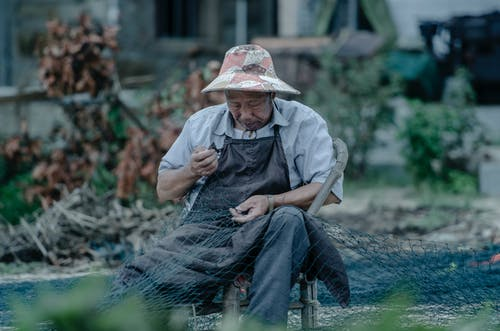 Photo of a Man Holding a Fishing Net