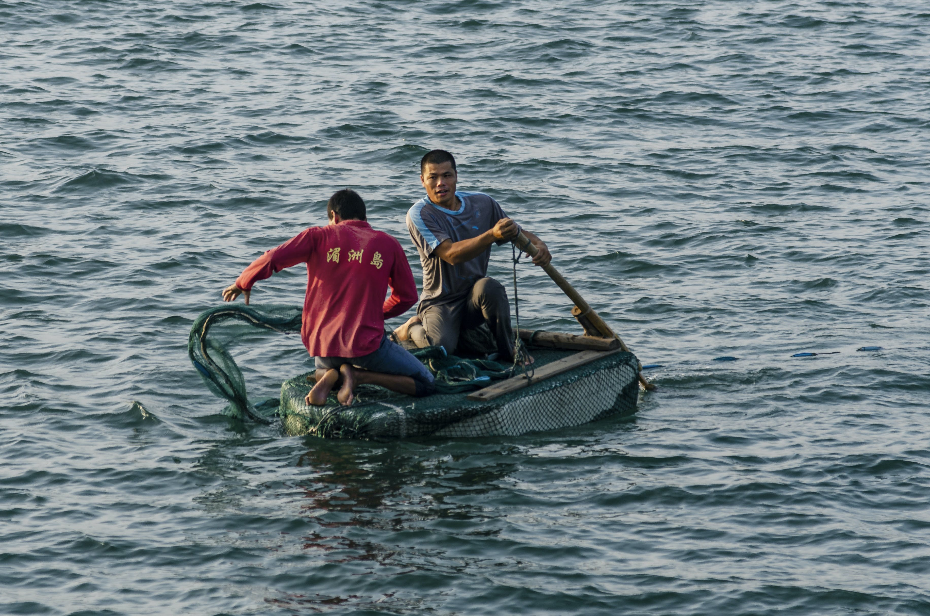 Two Man Riding Boat Photography