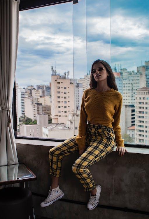 Woman Sitting on Window
