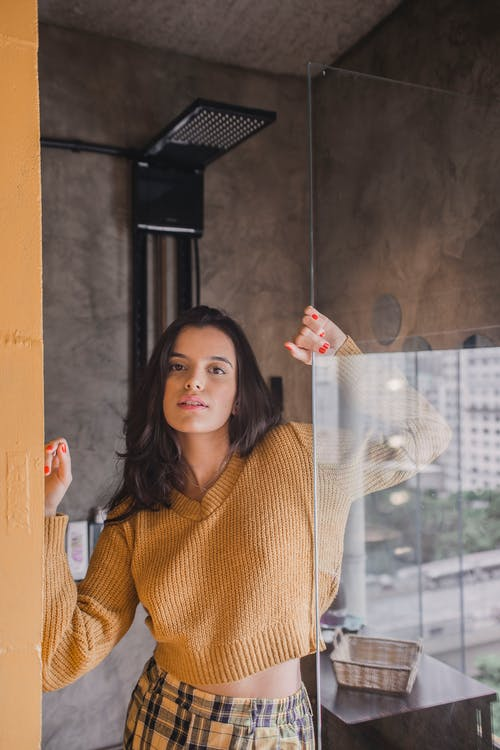 Woman Holding Glass Wall