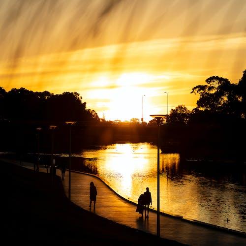 Δωρεάν στοκ φωτογραφιών με #αστικός, Άνθρωποι, δύση του ηλίου, κίτρινη