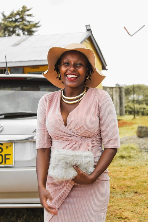 Smiling Woman Beside Vehicle
