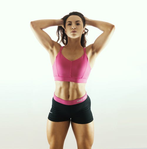 Woman In Pink Sports Bra And Black Shorts
