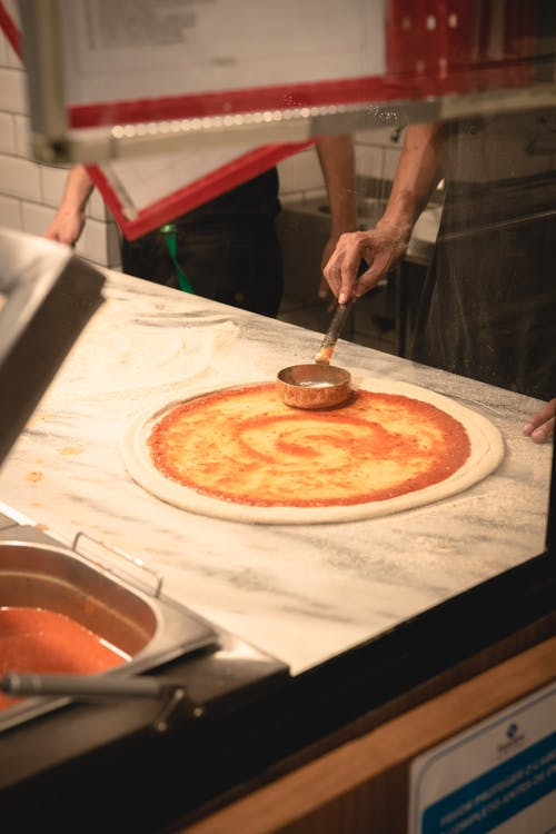 Photo Of Person Making A Pizza