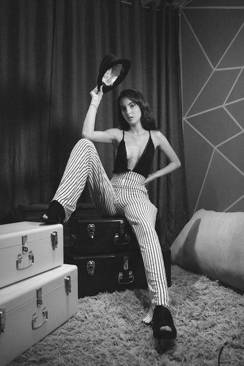Monochrome Photo Of Woman Wearing Striped Pants