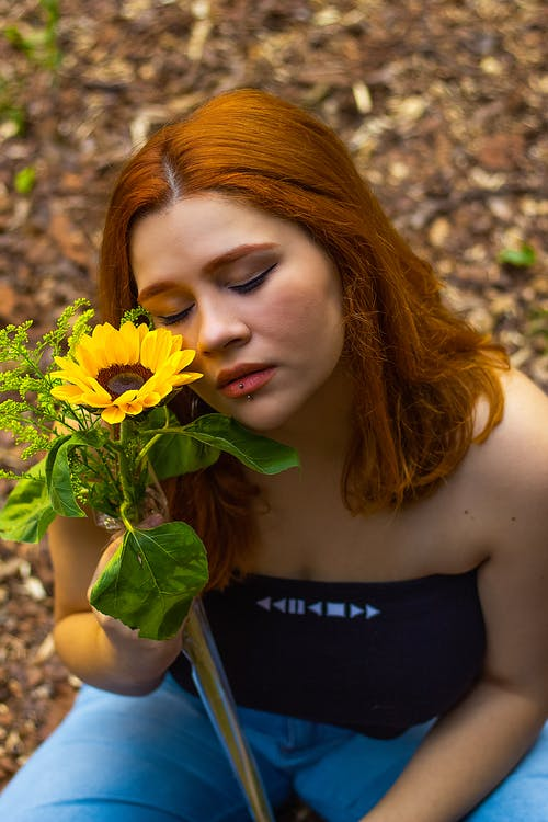 Free stock photo of red hair, sunflower field, sunflowers