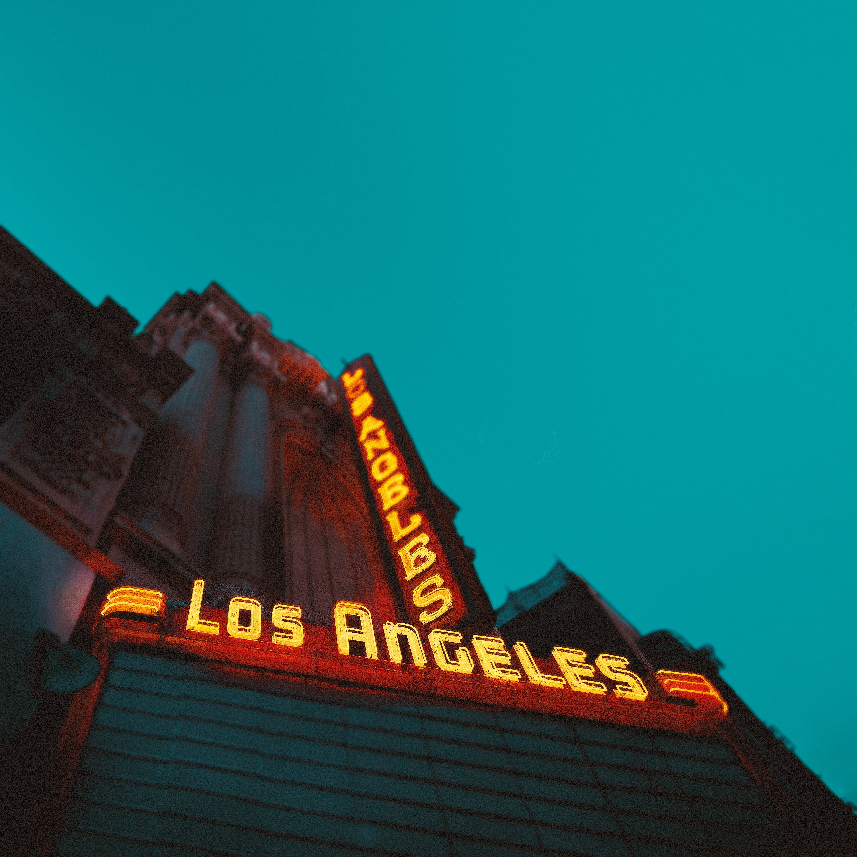 Low Angle Photography of Brown Building With Los Angeles Led Sign