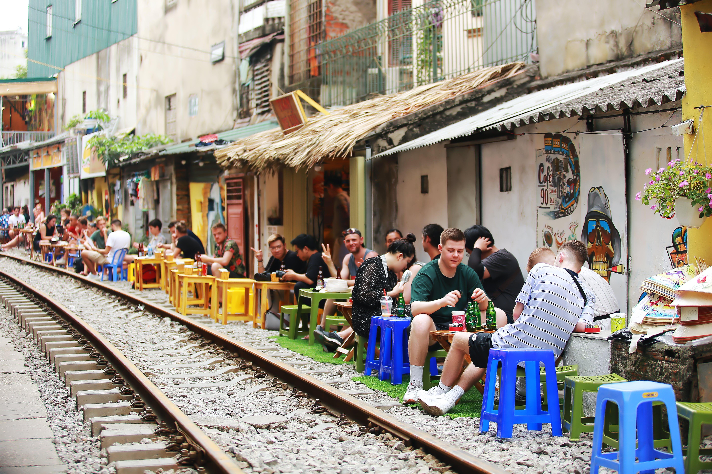 People Beside Train Railway