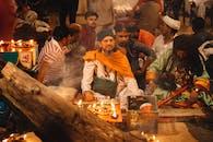 Men Sitting During A Celebration