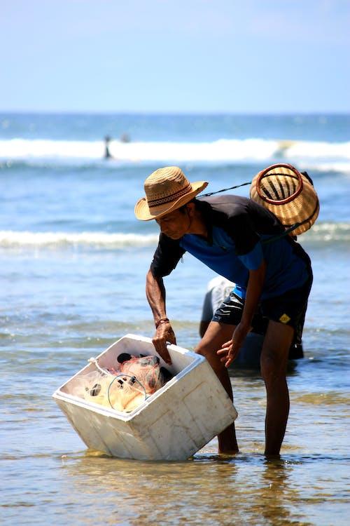 Man Holding Cooler Box