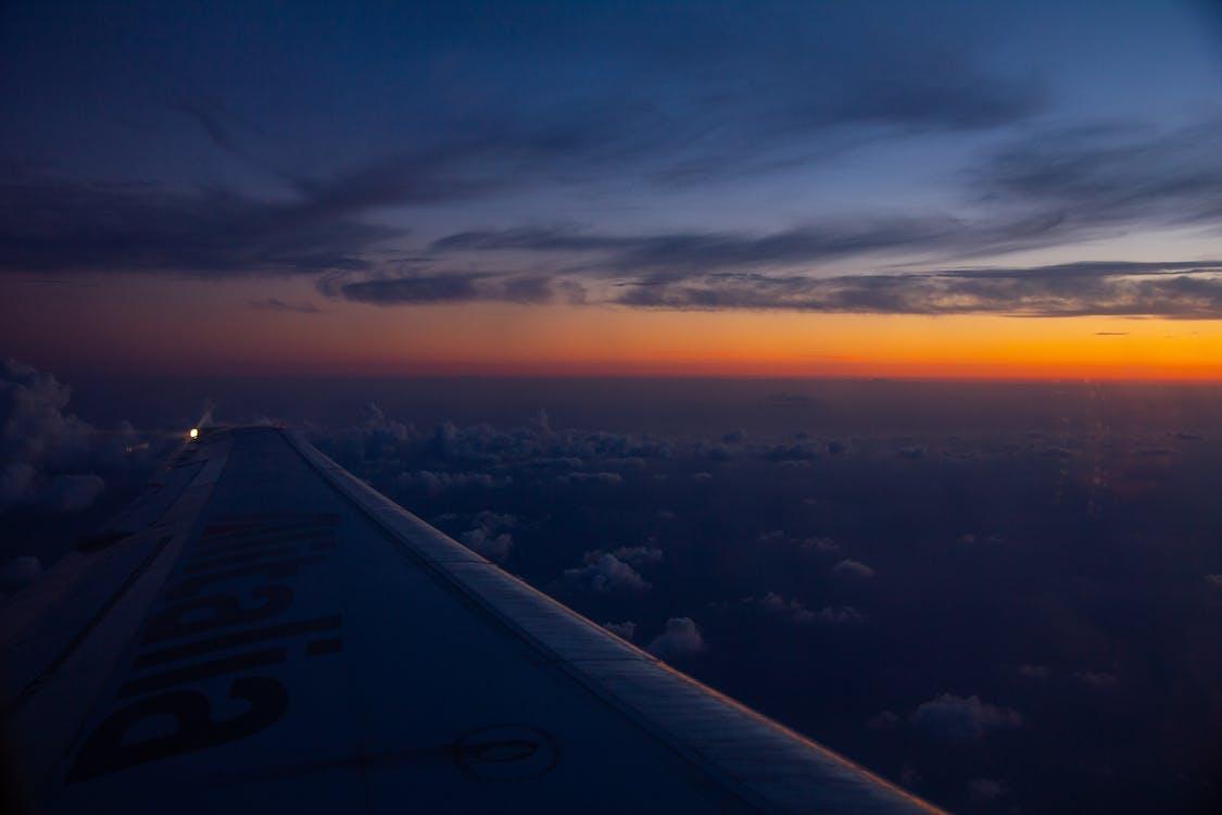 Plane Wings Flying on Sky Under Blue Sky