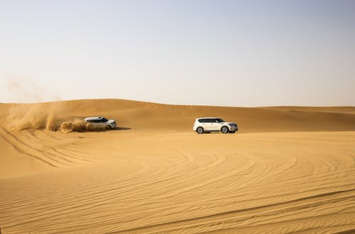 White Vehicles on Desert