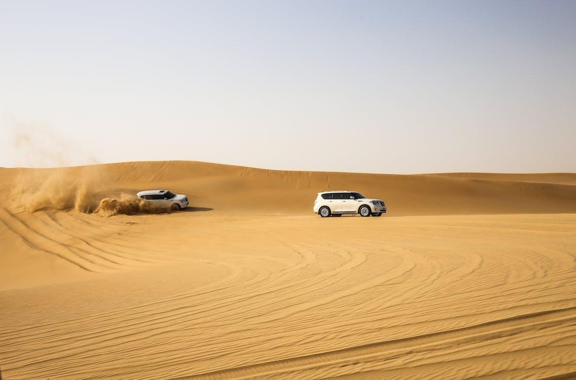 White Vehicles on Desert