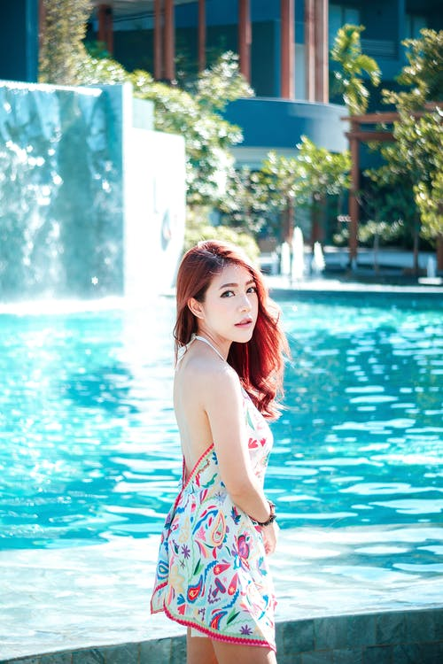Woman Standing Beside Pool