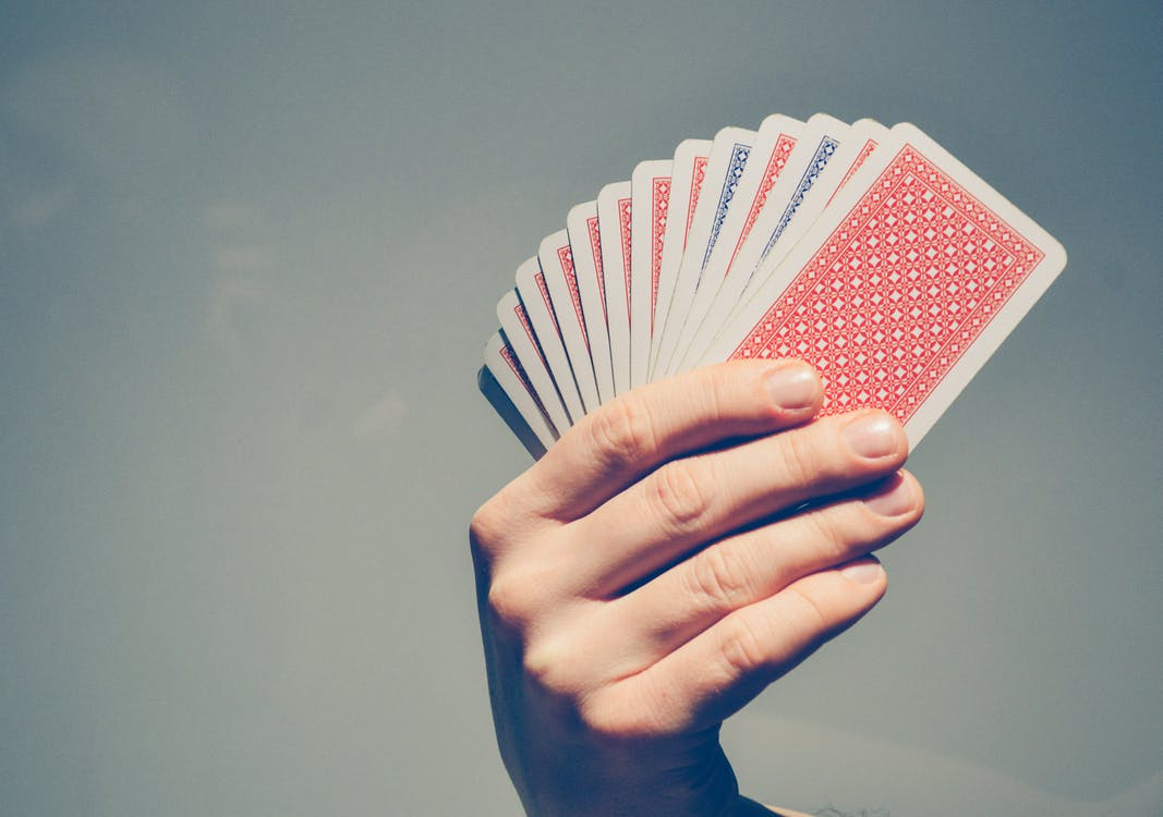 Person Holding Fan of Playing Cards
