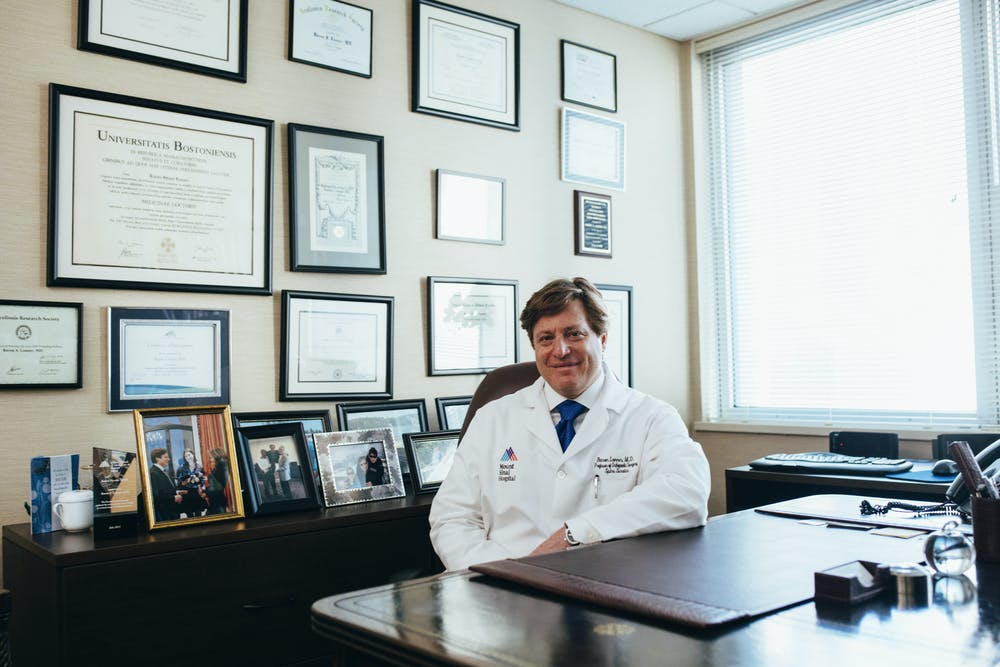 Doctor sitting in front of his desk. | Photo: Pexels