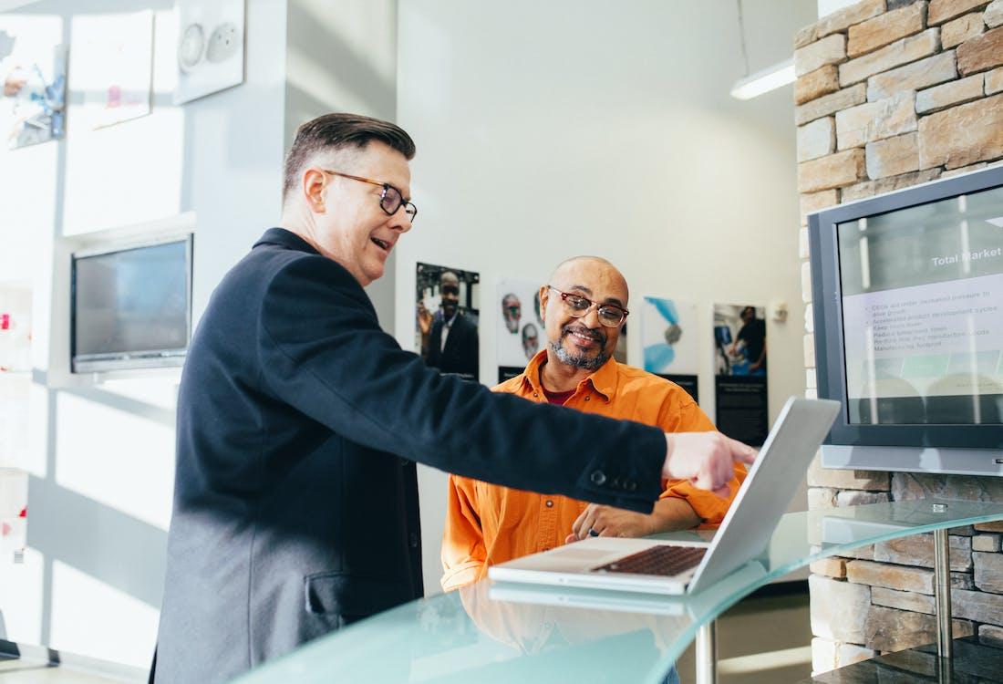Man Pointing Laptop Computer