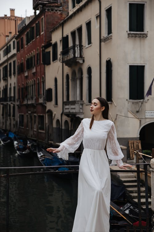 Photo Of Woman Wearing White Dress