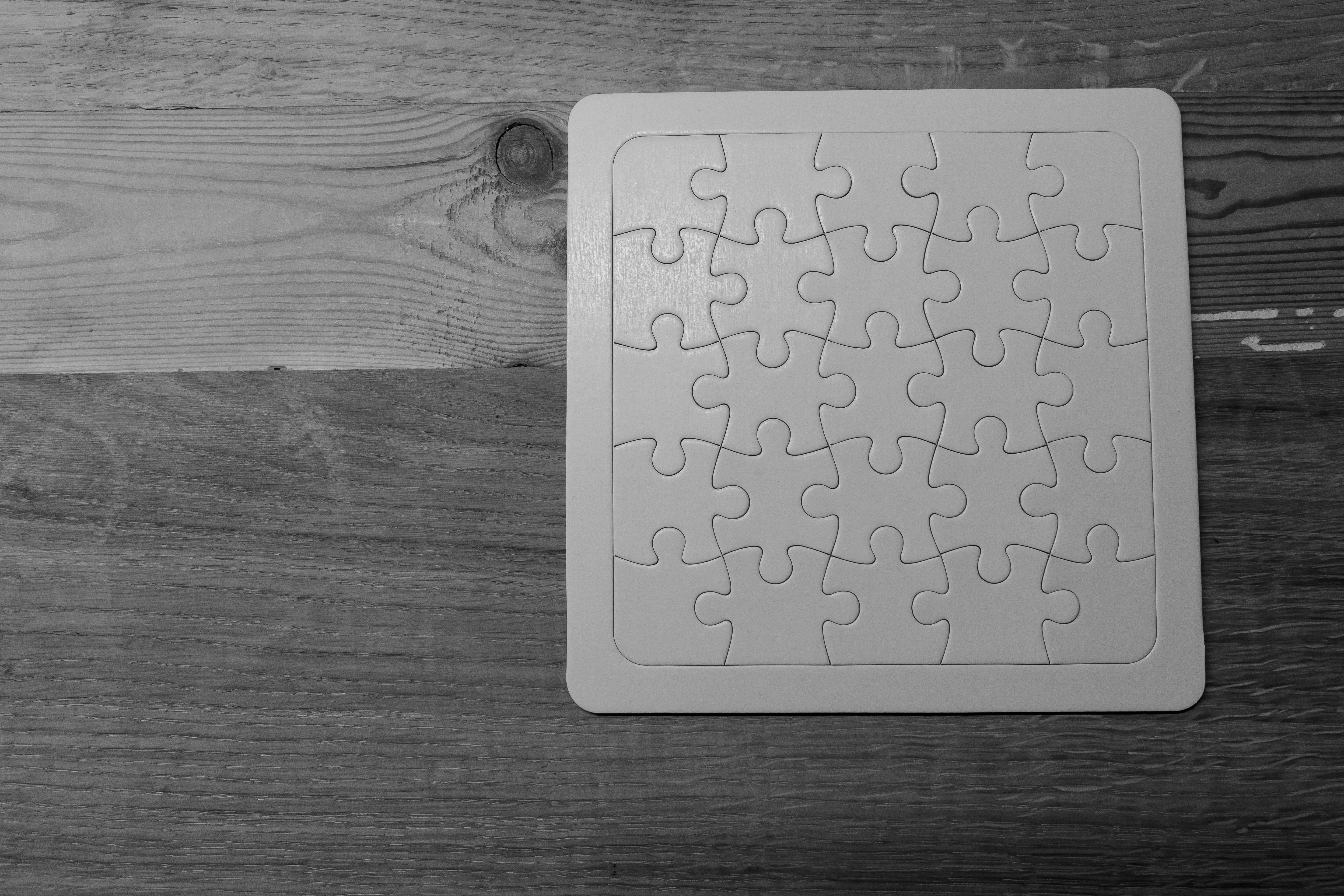 Gray Scale Photo of Jigsaw Puzzle