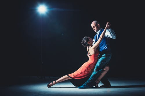 Woman And Man Dancing Under Light