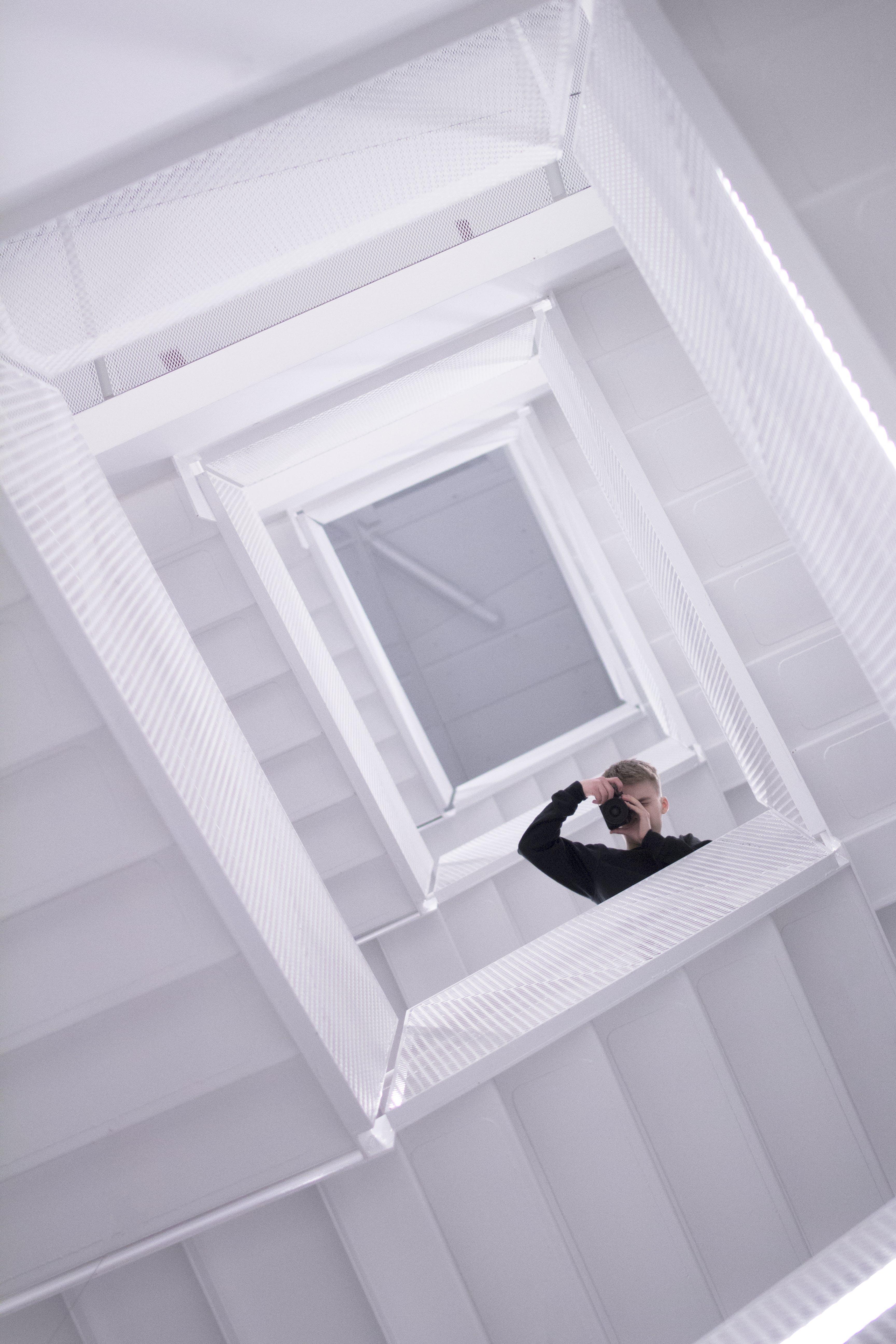 Photographer Wearing Black Long Sleeves