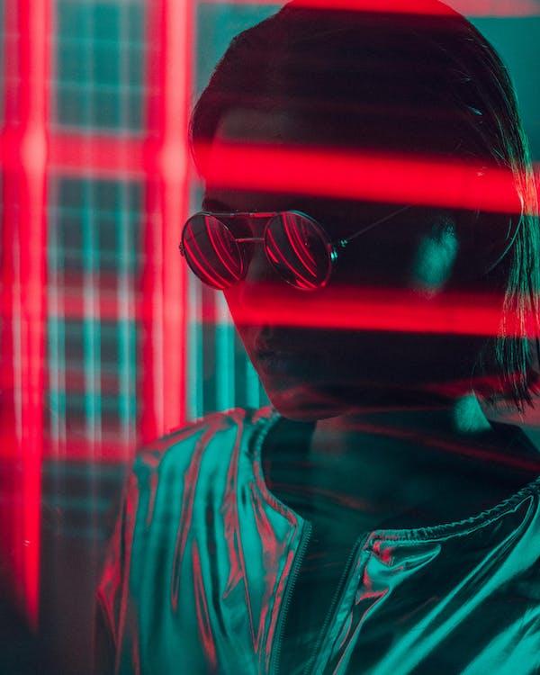 Woman Wearing Sunglasses Near Red Lights