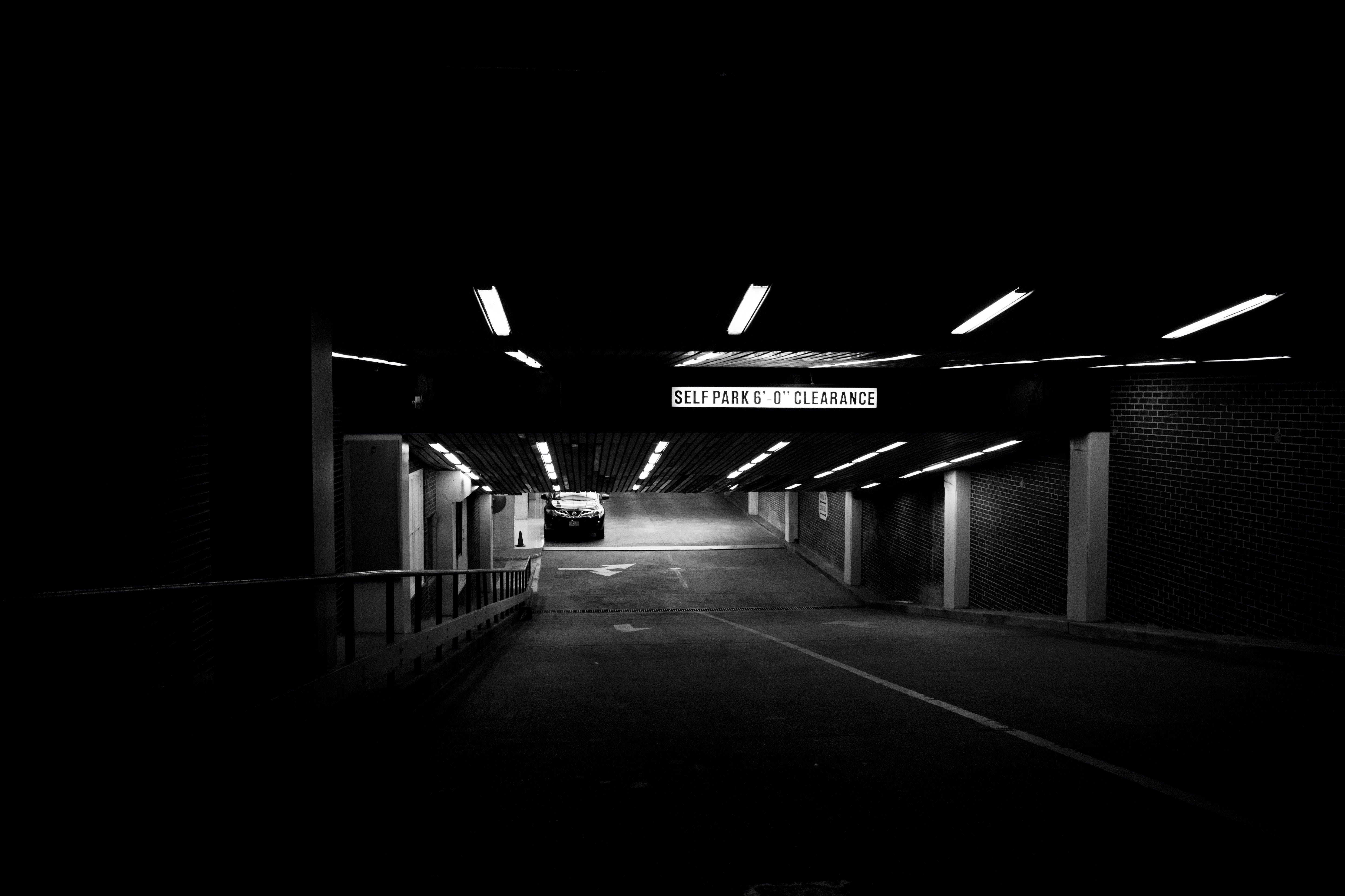 Grayscale Photo of a Concrete Road